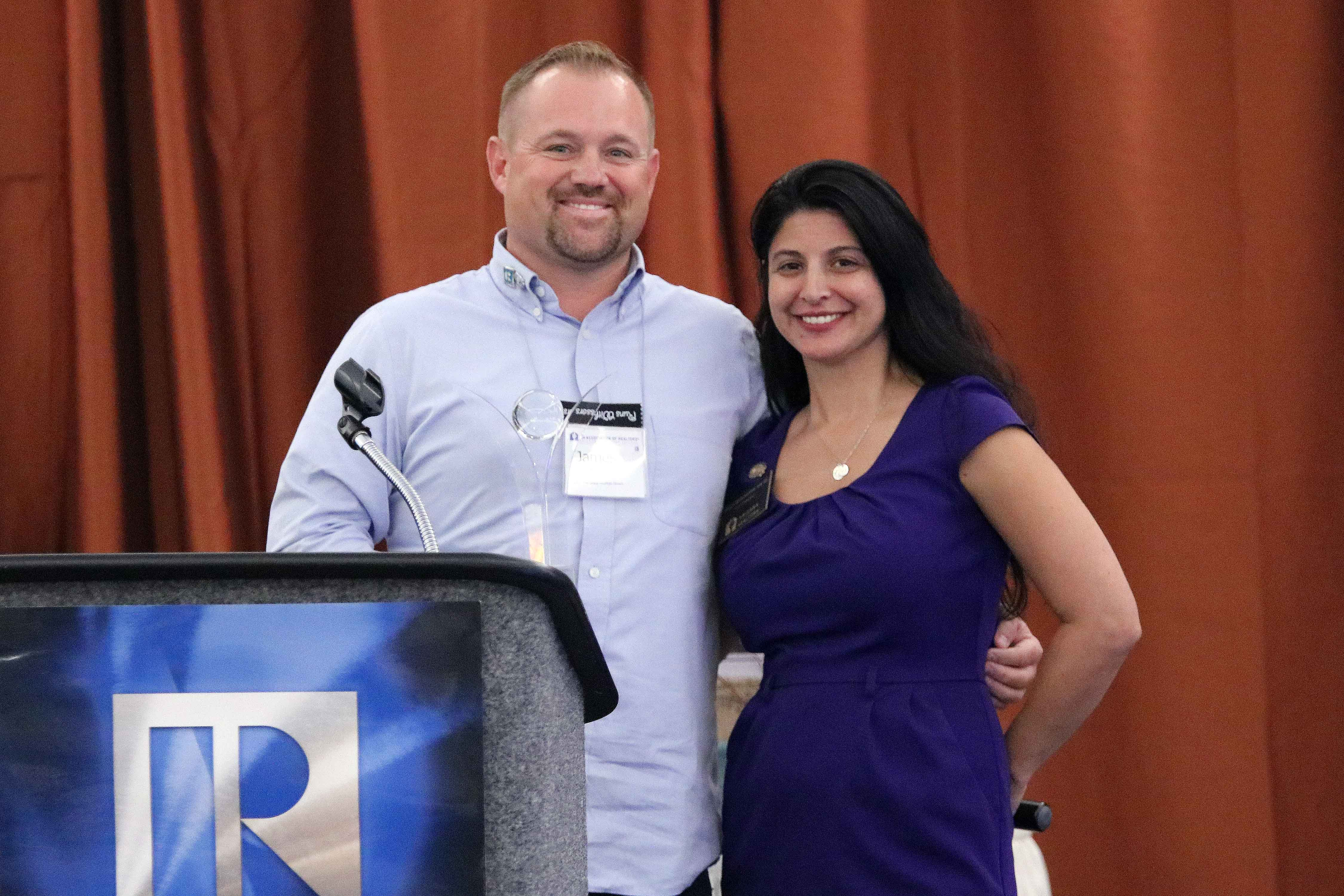 Arizona REALTORS® 2017 President Paula Monthofer presents the Community Outreach Local Association Award to James Adams who represented the Serdona Verde Valley Association of REALTORS®.